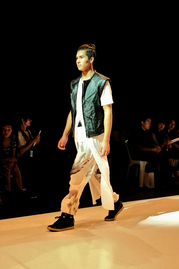 Amy Le leather biker vest over flowing white shirt and white print pants - Menswear : Raffles Graduate Fashion Parade 2013 Photography by Kent Johnson.
