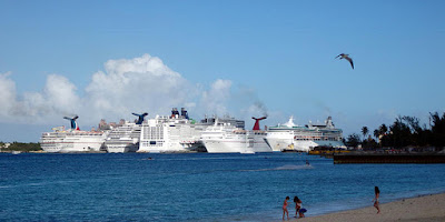 Cruise ships crowded into port.