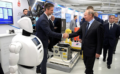 Vladimir Putin at the ER-Telecom Holding IT exhibition.