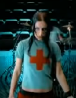 Red Cross shirt worn by Sandra Nasić of Guano Apes in Big In Japan music video. PYGear.com