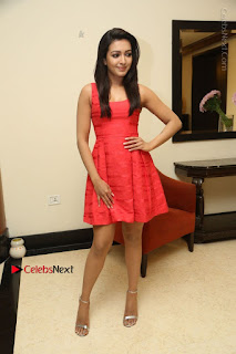 Actress Catherine Tresa Latest Pos in Red Short Dress at Intex Air Conditioners Launch  0036.jpg