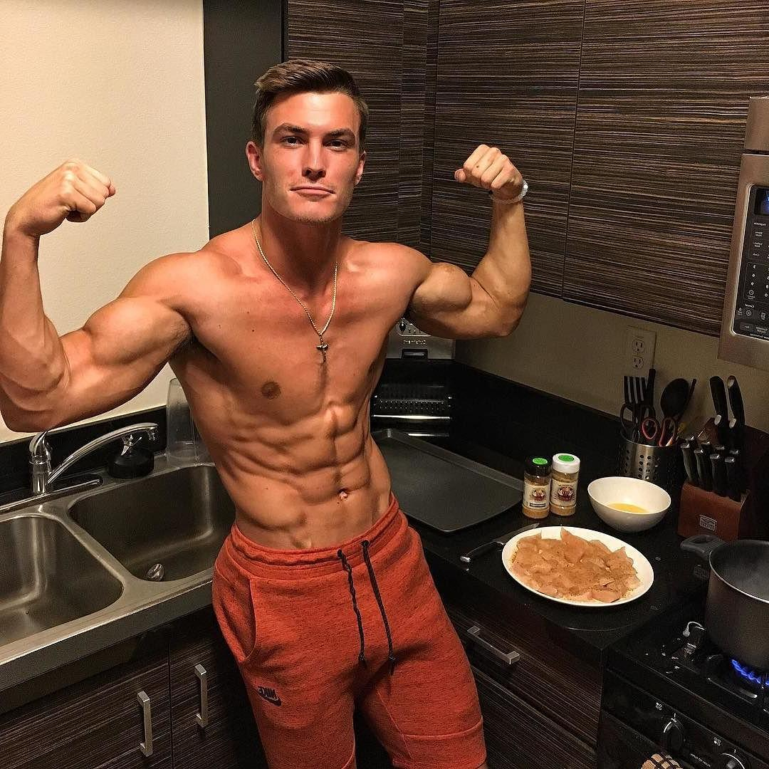 shirtless-fit-young-man-kitchen-flexing-biceps-sixpack-abs