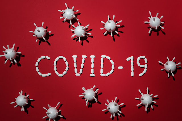 Covid-19 written in white on a red background