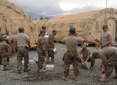 American troops opening care packages.