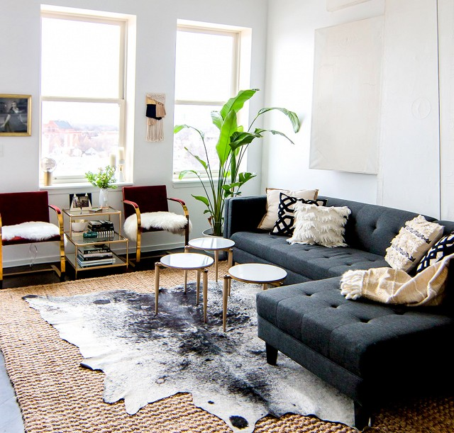 Modern Furniture with Layered Jute and Cowhide Rugs
