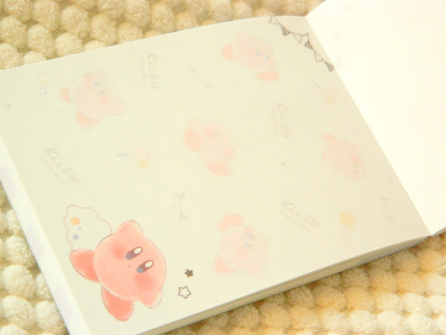 A photo showing a notepad, the pages decorated with kirby illustrations