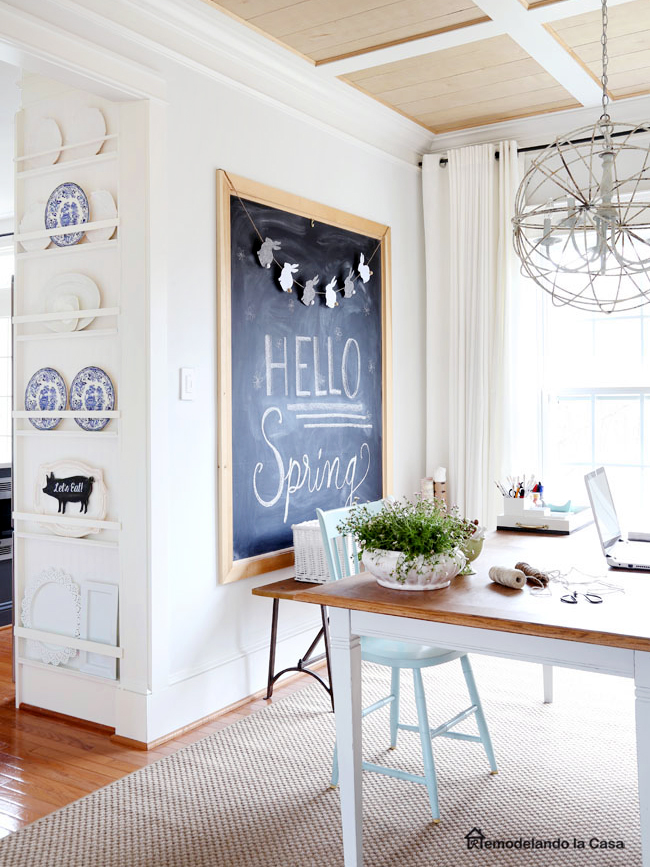 big chalkboard in home office with plate rack on the side