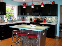 Kitchen island as bar features red stools