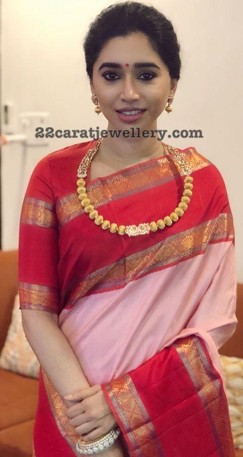 Aarthi Ravi Bold Balls set with Kundan Motifs