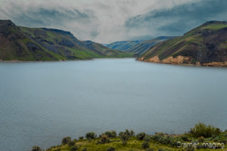 Cramer Imaging's quality landscape photograph of Ririe Reservoir with cloudy skies and choppy lake water in Idaho