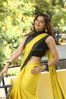 Cute Actress Ashwini in Yellow Saree Exclusive  028.JPG