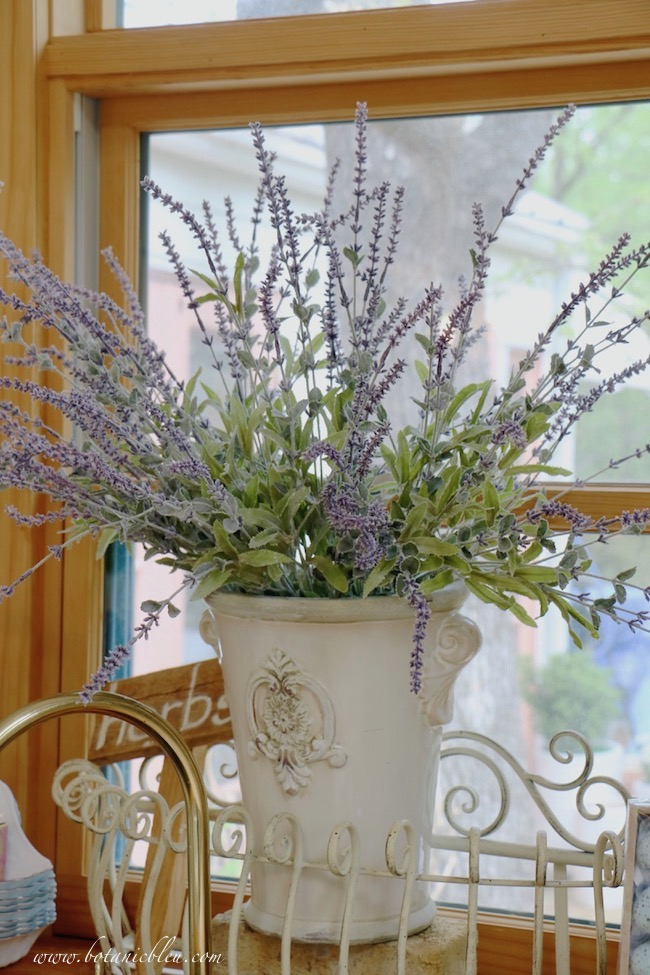 French Country is in the details with a white vase filled with faux French lavender