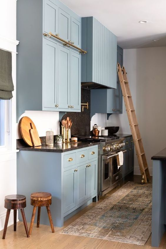 Blue kitchen cabinets with black granite