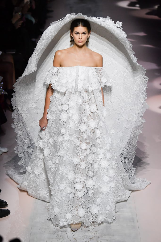 Kaia Gerber turns the Givenchy catwalk into her very own wedding chapel in sweeping white sheer gown at Paris Fashion Week