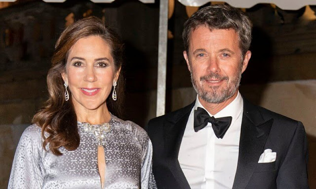 Crown Princess Mary wore a faye silver silk gown by Temperley London. Furmani stone flap silver clutch, Gianvito Rossi Fumo Grey suede pumps