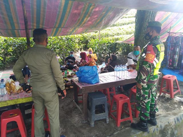 Personel Jajaran Kodim 0207/Simalungun Laksanakan Razia Masker Diwilayah Binaan