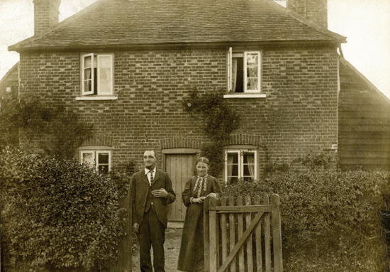 Photograph of Mr & Mrs Pollard outside number 47 Dixons Hill Road. Mr Pollard was killed whilst tree felling in Brookmans Park in the 1900s - Image from E. Stamp