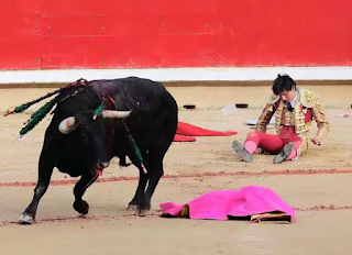 Teenage bullfighter at Pamplona bull festival Spain