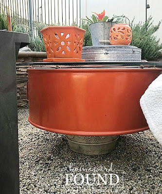 fall, outdoor decor, outdoor fall decor, salvaged, upcycled, repurposed, junk makeover, industrial style, trash to treasure, orange accent color, firepit area decor, backyard decor,  use what you have decorating, farmhouse style, DIY, DIY decorating, DIY project, salvaged metal industrial fan becomes outdoor table