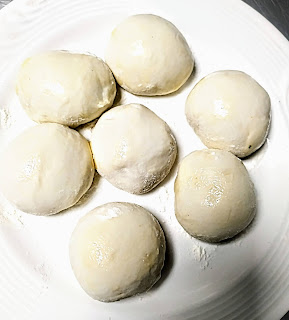 Making dough balls for bhature recipe