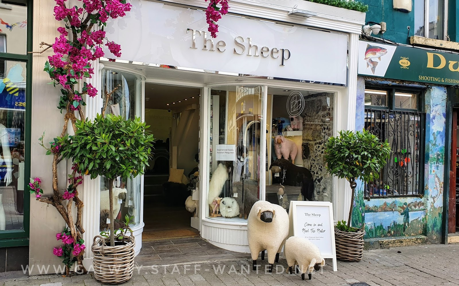 Come in and meet the maker sign beside artifical sheep in galway