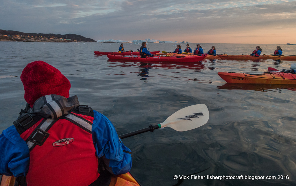 Greenland kayaking adventure travel sunset photography Ilulissat icebergs Disko Bay water cold ice group paddle Denmark