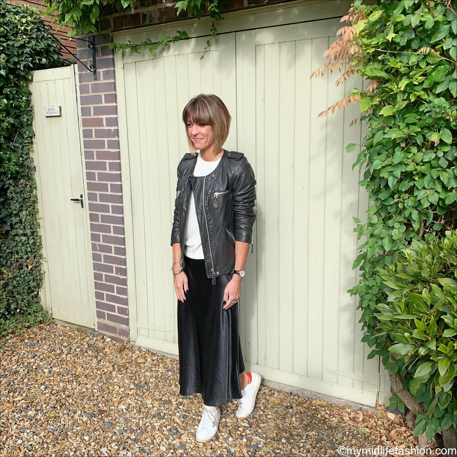 my midlife fashion, Isabel Marant Etoile leather biker jacket, marks and Spencer pure cashmere round neck jumper, marks and Spencer slip midi skirt, golden goose superstar low top leather trainers