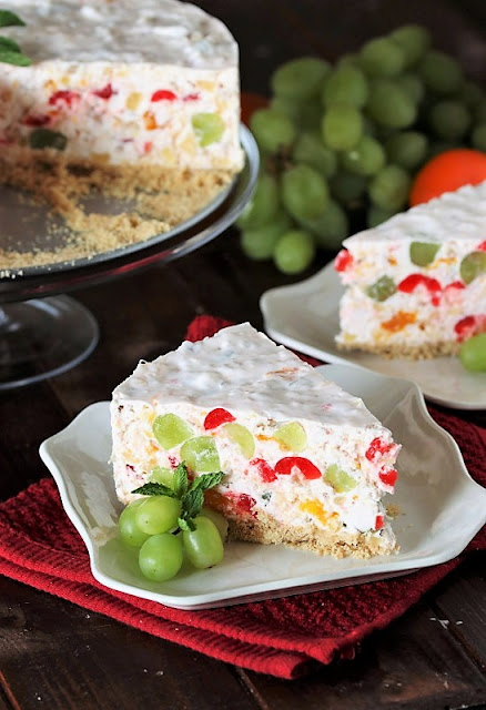Fruit Salad Cheesecake with Maraschino Cherries and Nilla Wafer Crust image