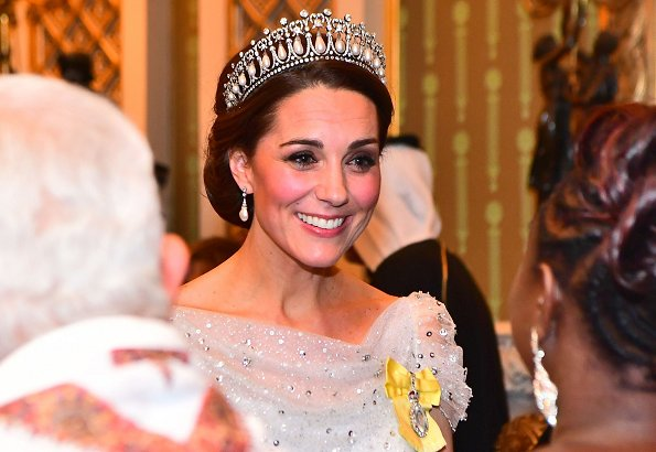 The Duchess of Cambridge wearing Lover's Knot tiara with a pale blue, fitted bespoke Jenny Packham gown