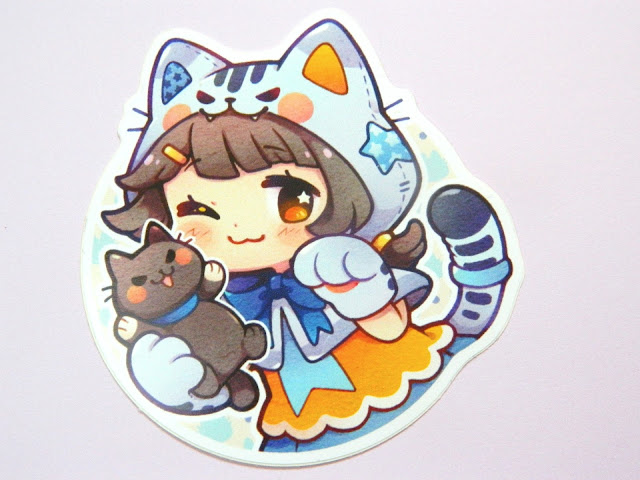 A sticker of a chibi-style character dressed as a cat/neko