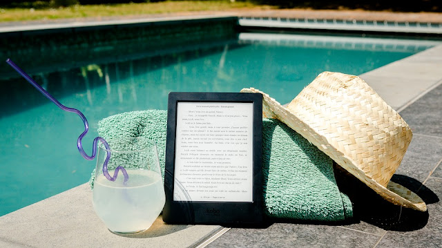 Image: Reading by the pool, by Perfecto_Capucine on Pixabay
