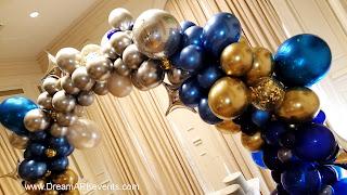 Gold, royal blue, confetti balloons, organic balloon arch