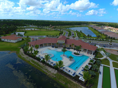 View of community pool and club house at Renaissance at The West Villages