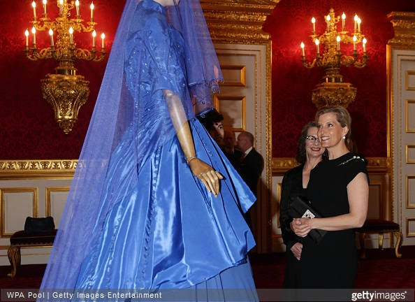 Sophie, Countess of Wessex looks at a dress on display during a reception for the London College of Fashion at St James's Palace