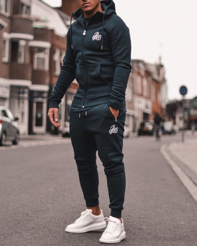 A man wearing Athleisure track suit.