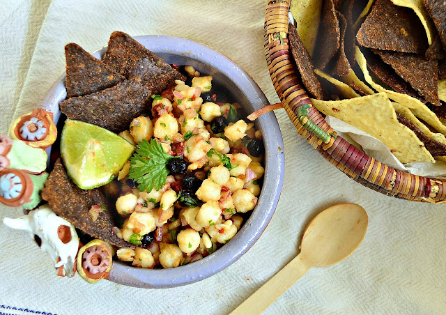 This hominy and dried blueberry salsa with a touch of red onion and lime is a fresh take on salsa. If you've never had hominy this is a great way to try it! www.thisishowicook.com #salsa #hominy