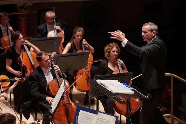 Garry Walker conducting the Orchestra of Opera North (Photo Justin Slee)