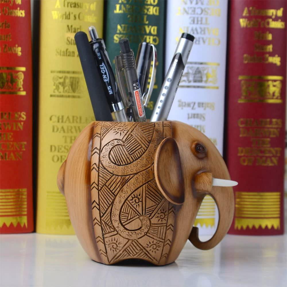 carved elephant pencil holder