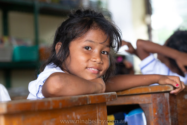 Young Cambodian girl smiling beautifully at having her photo taken