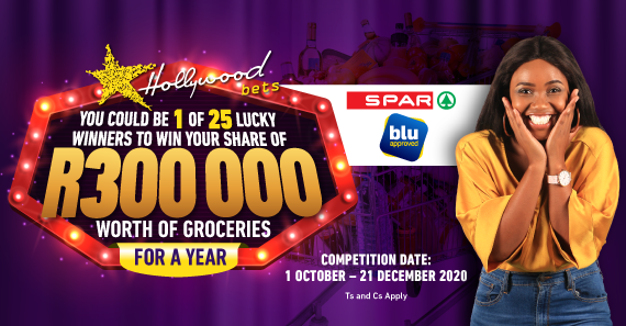 Woman poses excitedly - win a share of R300 000 worth of groceries with Hollywoodbets and SPAR