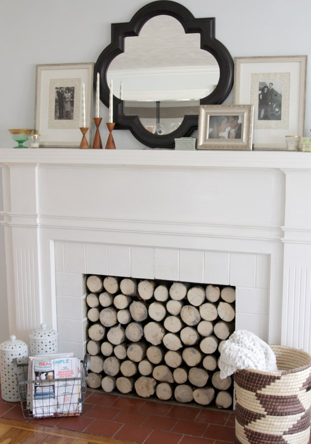 Stacked log fireplace insert to create a cozy farmhouse look for fall