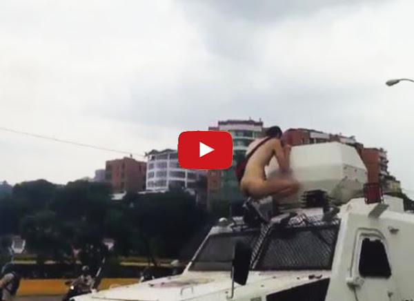 Jóven se quitó toda la ropa y se montó sobre vehículo de la GNB