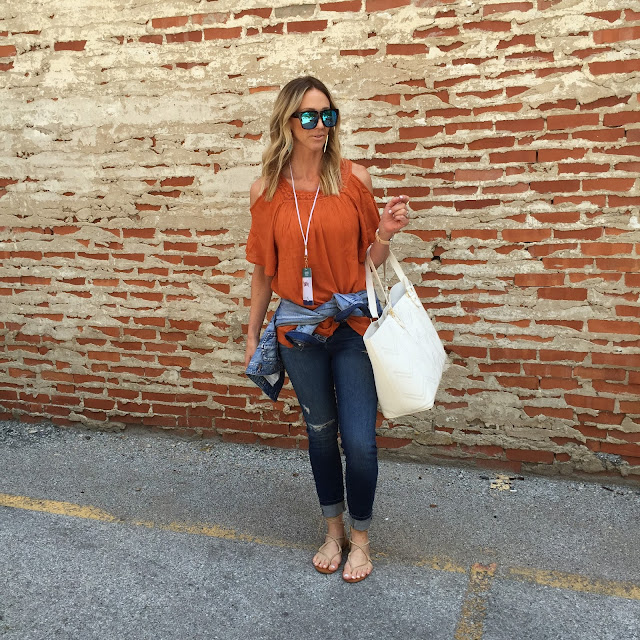 orange cold shoulder top ripped jeans