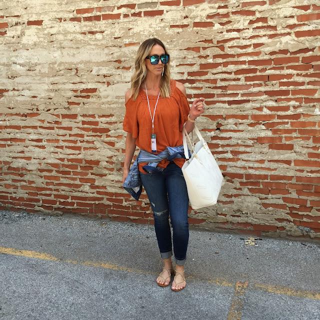 orange cold shoulder top ripped jeans