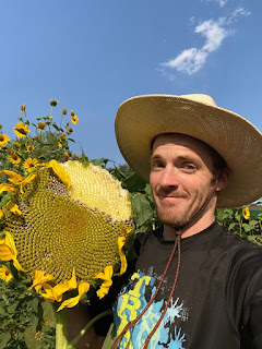 Man with Giant Sunflower Head