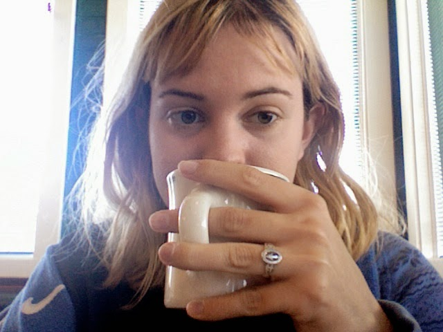Photo of me drinking coffee in a diner with very unkempt hair