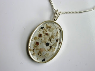 Ashes incorporated into a sterling silver oval keepsake necklace