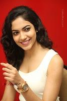 Actress Ritu Varma Stills in White Floral Short Dress at Kesava Movie Success Meet .COM 0207.JPG