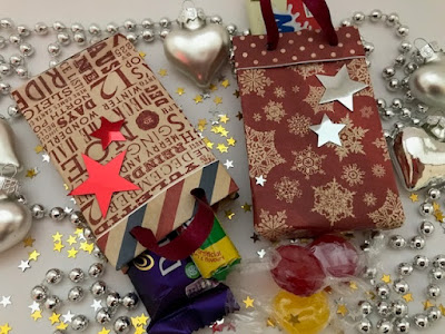 Mini Christmas themed gift bags with Bostik