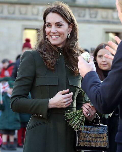 Kate Middleton wore a green Alexander McQueen coat, a print dress by Zara, Zeen ceramic earrings and Aspinal of London Mayfair bag